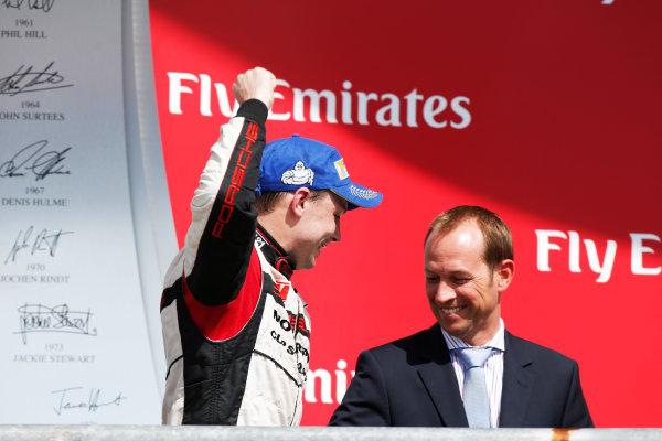 2014 Porsche Supercup. Sunday 2 November 2014. Earl Bamber, No.19 Fach Auto Tech, 2nd Position, celebrates championship victory. World Copyright: /LAT Photographic. ref: Digital Image _W2Q7127