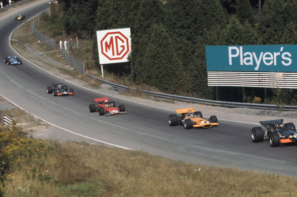1969 Canadian Grand Prix.  Mosport, Canada. 18-20th September 1969.  Jackie Oliver, BRM P139, leads Bruce McLaren, McLaren M7C Ford, John Miles, Lotus 63 Ford, and John Surtees, BRM P139, as Silvio Moser, Brabham BT24 Ford, crashes out in the background on lap one.  Ref: 69CAN15. World Copyright: LAT Photographic