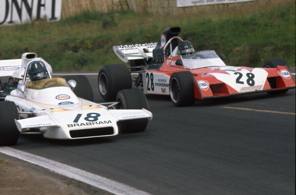 1972 French Grand Prix.  Clermont-Ferrand, France. 30th June - 2nd July 1972.  Graham Hill, Brabham BT37 Ford, 10th position, passes Andrea de Adamich, Surtees TS9B Ford, 14th position.  Ref: 72FRA24. World Copyright: LAT Photographic