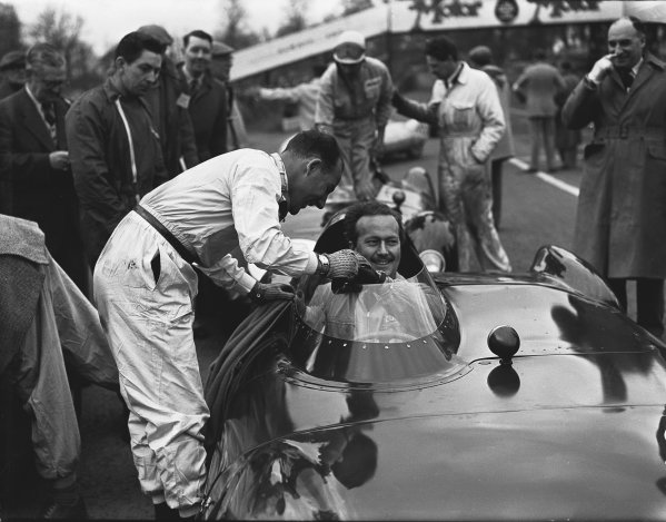 Oulton Park, Cheshire, England. 14th April 1956.Stirling Moss (Cooper Bobtail MkII), 1st position, position, shakes hands with Colin Chapman (Lotus Eleven), retired, before the start of the final race, portrait.World Copyright: LAT Photographic.Ref:  Autocar Glass Plate C45969.