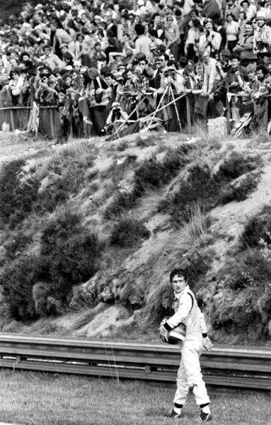 Patrick Depailler (FRA) Ligier walks back to the pits after crashing out from the lead of the race on lap 46.Belgian Grand Prix, Rd 6, Zolder, Belgium, 13 May 1979.
