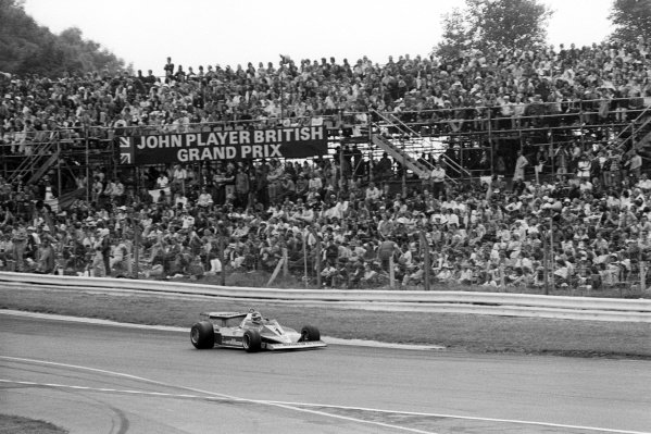Race winner Carlos Reutemann (ARG) Ferrari 312T3 passes the packed grandstand at the end of the lap.British Grand Prix, Rd 10, Brands Hatch, England, 16 July 1978.
