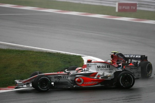 Sebastian Vettel (GER) Scuderia Toro Rosso STR02 hits Fernando Alonso (ESP) McLaren Mercedes MP4/22 