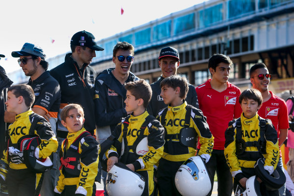 Circuit de Catalunya, Barcelona, Spain. Thursday 11 May 2017. Sergio Perez, Force India, Esteban Ocon, Force India, Daniil Kvyat, Toro Rosso,Stoffel Vandoorne, McLaren, and some junior Kart racers. World Copyright: Dom Romney/LAT Images ref: Digital Image GT2R9772