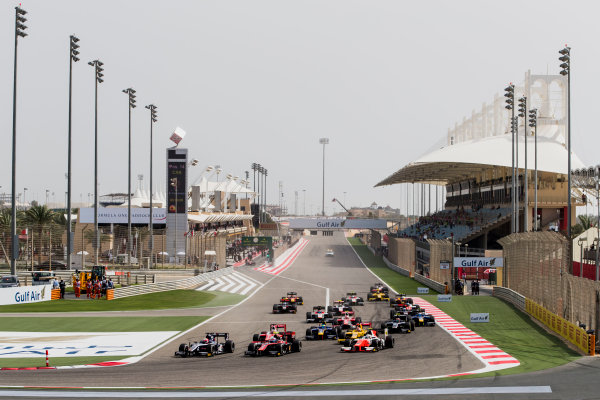 2017 FIA Formula 2 Round 1. Bahrain International Circuit, Sakhir, Bahrain.  Sunday 16 April 2017. Luca Ghiotto (ITA, RUSSIAN TIME) leads Alexander Albon (THA, ART Grand Prix) and the rest of the field at the start of the race. Photo: Zak Mauger/FIA Formula 2. ref: Digital Image _56I1831