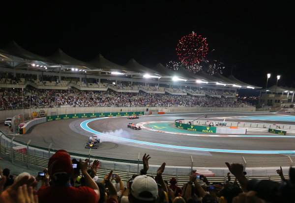 Race winner Sebastian Vettel (GER) Red Bull Racing RB9 celebrates with donuts as fireworks illuminate the night sky. Formula One World Championship, Rd17, Abu Dhabi Grand Prix, Race Day, Yas Marina Circuit, Abu Dhabi, UAE, Sunday 3 November 2013. BEST IMAGE
