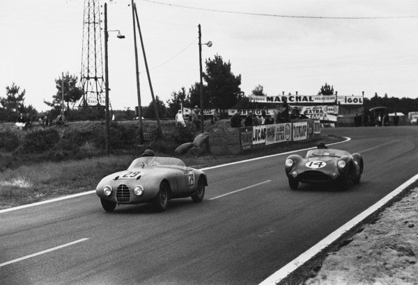 Le Mans, France. 28th - 29th July 1956 Andre Milhoux/Charles Rinen (Gordini T17S), retired, leads Tony Brooks/Reg Parnell (Aston Martin DBR1/25), Not classified, action. World Copyright: LAT Photographic Ref: 7114F - 22A-23.