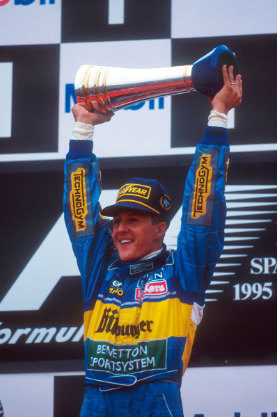 Spa-Francorchamps, Belgium.25-27 August 1995.Michael Schumacher (Benetton Renault) celebrates 1st position on the podium.Ref-95 BEL 06.World Copyright - LAT Photographic