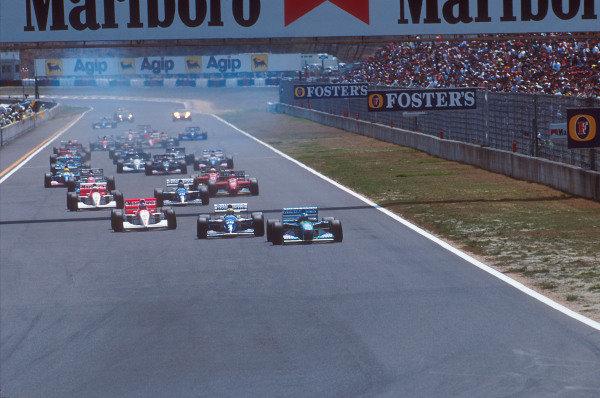 Tanaka International, Aida, Japan.15-17 April 1994.Michael Schumacher (Benetton B194 Ford) leads Ayrton Senna (Williams FW16 Renault), Mika Hakkinen, Martin Brundle (both McLaren MP4/9 Peugeot's) and Damon Hill (Williams FW16 Renault) at the start.Ref-94 PAC 02.World Copyright - LAT Photographic