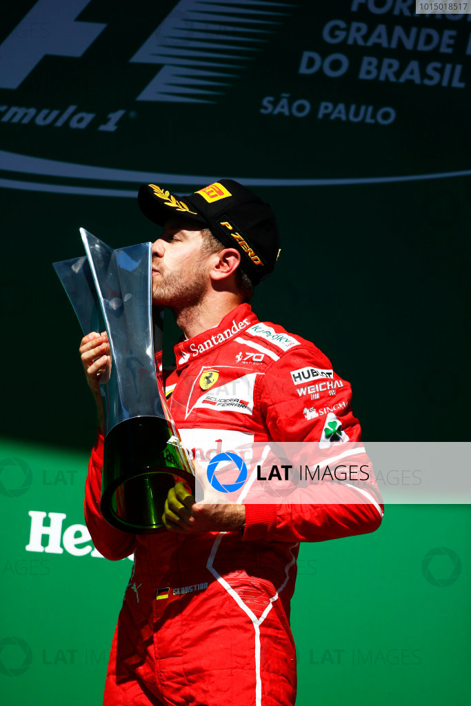 Interlagos, Sao Paulo, Brazil. Sunday 12 November 2017. Sebastian Vettel, Ferrari, 1st Position, kisses his trophy on the podium. World Copyright: Andy Hone/LAT Images  ref: Digital Image _ONZ6886