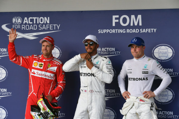 (L to R): Sebastian Vettel (GER) Ferrari, pole sitter Lewis Hamilton (GBR) Mercedes AMG F1 and Valtteri Bottas (FIN) Mercedes AMG F1 celebrate in parc ferme at Formula One World Championship, Rd17, United States Grand Prix, Qualifying, Circuit of the Americas, Austin, Texas, USA, Saturday 21 October 2017.