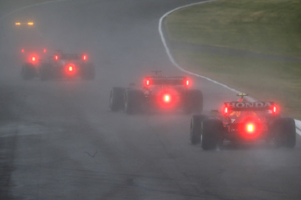 Charles Leclerc, Ferrari SF21, leads Sergio Perez, Red Bull Racing RB16B