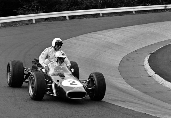 1967 German Grand Prix.Nurburgring, Germany.4-6 August 1967.Denny Hulme (Brabham BT24 Repco) gives a lift to team-mate Jack Brabham after they finished in 1st and 2nd positions respectively.World Copyright - LAT Photographic