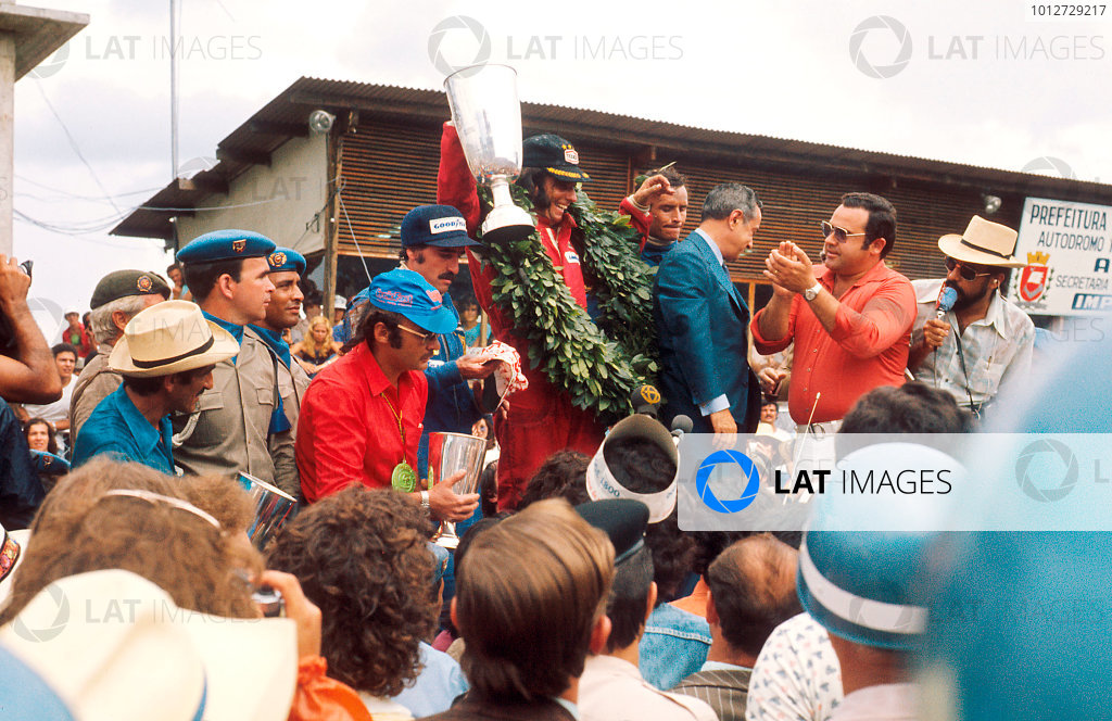 1974 Brazilian Grand Prix.Interlagos, Sao Paulo, Brazil.25-27 January 1974.Emerson Fittipaldi (McLaren Ford) 1st position, Clay Regazzoni (Ferrari) 2nd position and Jacky Ickx (Team Lotus) 3rd position on the podium.Ref-74 BRA 04.World Copyright - LAT Photographic