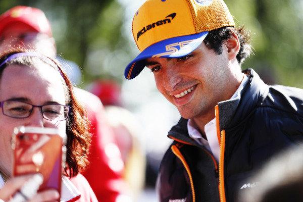 Lando Norris, McLaren signs autographs for fans.
