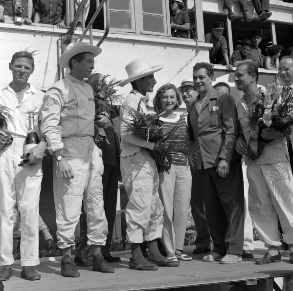 Paul Frère and Olivier Gendebien, 1st position, on the podium with other Class winners.