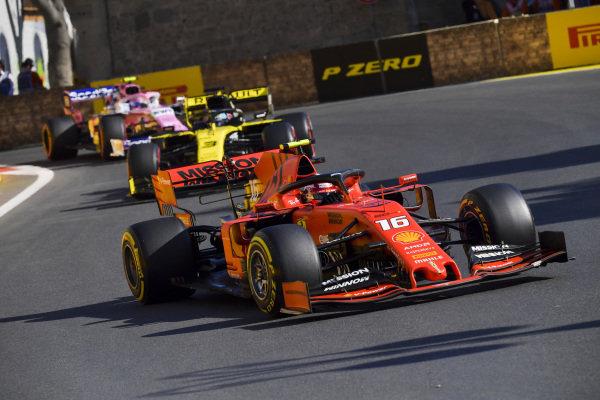 Charles Leclerc, Ferrari SF90, leads Daniel Ricciardo, Renault R.S.19, and Lance Stroll, Racing Point RP19