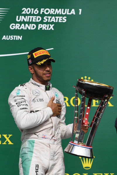 Race winner Lewis Hamilton (GBR) Mercedes AMG F1 on the podium with the trophy at Formula One World Championship, Rd18, United States Grand Prix, Race, Circuit of the Americas, Austin, Texas, USA, Sunday 23 October 2016.