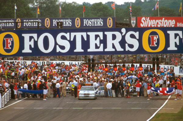 Silverstone, England.12-14 July 1996.The grid is packed with people before the start of the race. At the front of it sits the safety car.Ref-96 GB 26.World Copyright - LAT Photographic