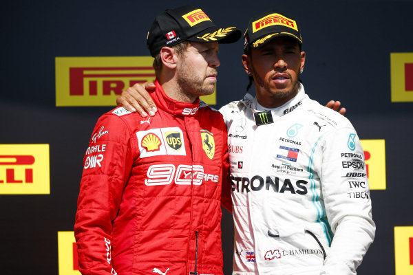 Sebastian Vettel, Ferrari and Lewis Hamilton, Mercedes AMG F1 on the top step of the podium