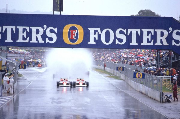 1989 Australian Grand Prix.Adelaide, Australia.3-5 November 1989.Ayrton Senna and Alain Prost (Both McLaren MP4/5 Honda's) kick up the spray as they both head down to the first turn together side by side at the start.Ref-89 AUS 11.World Copyright - LAT Photographic