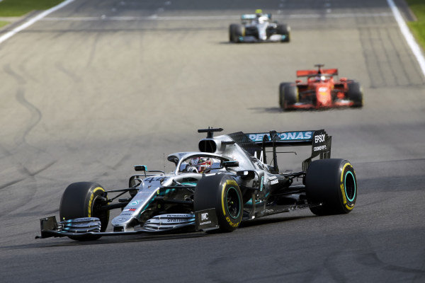 Lewis Hamilton, Mercedes AMG F1 W10, leads Sebastian Vettel, Ferrari SF90, and Valtteri Bottas, Mercedes AMG W10