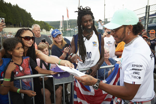 Lewis Hamilton, Mercedes AMG F1, signs autographs for fans and poses for pictures