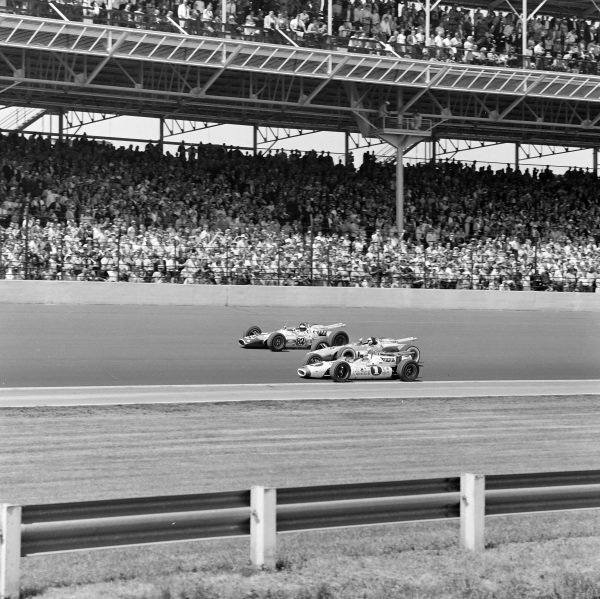 George Snider, Ansted-Thompson Racing, Lotus 38 Ford, looks over at defending race-winner Jim Clark, Lotus 38 Ford, and defending national champion Mario Andretti, Al Dean, Hawk Ford, on the front row on the formation laps.