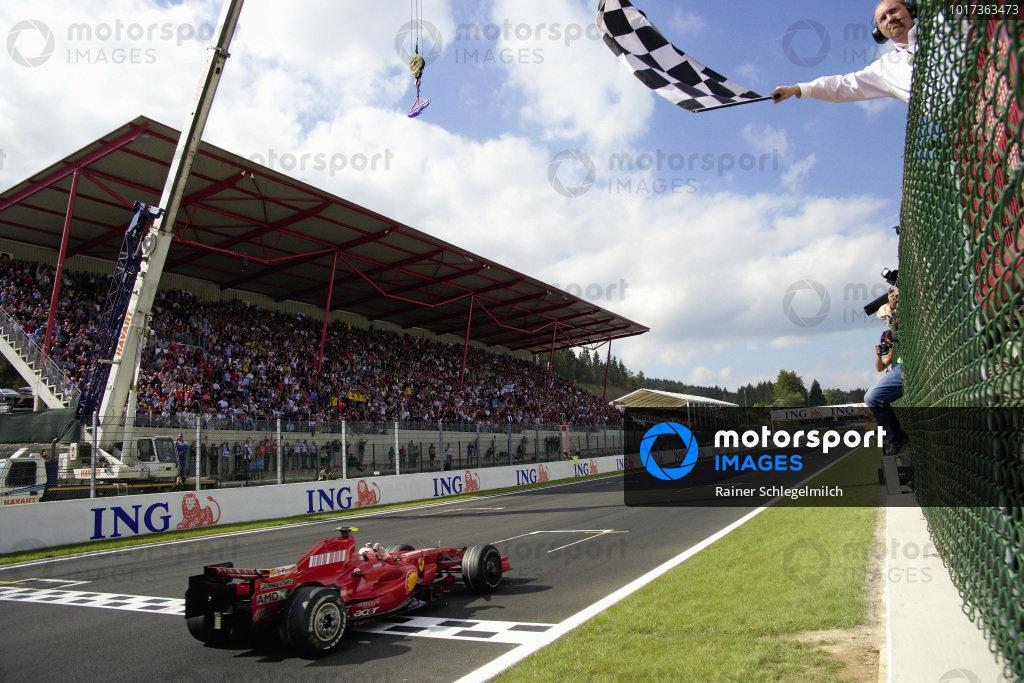 Kimi Räikkönen, Ferrari F2007 celebrates victory as he takes the chequered flag.