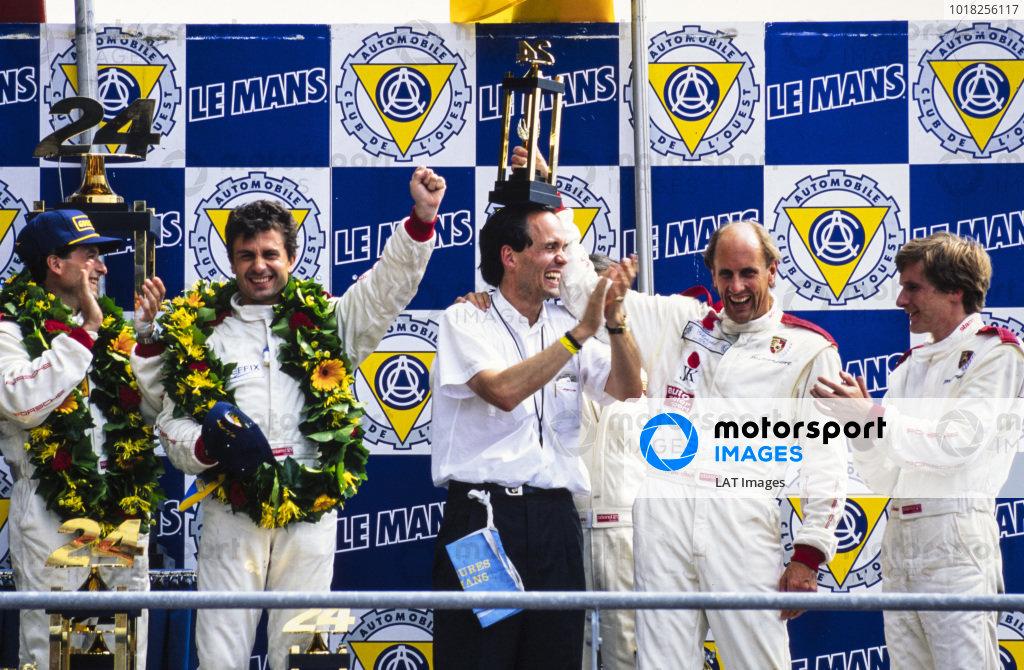 Hans-Joachim Stuck Jr and Thierry Boutsen celebrate on the podium with race winners Mauro Baldi, Yannick Dalmas and Max Welti.