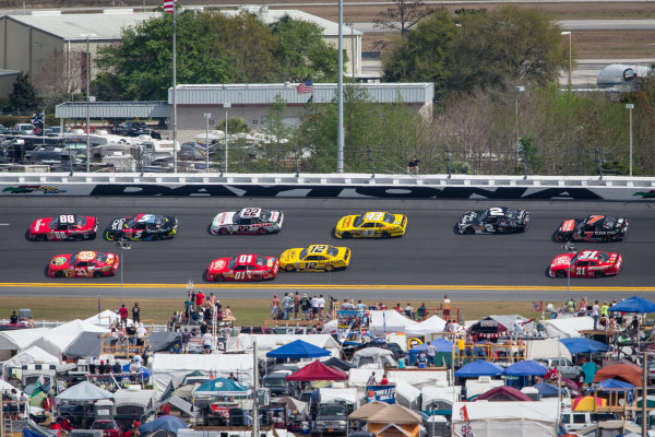 Dale Earnhardt Jr. and Tony Stewart lead a group of cars