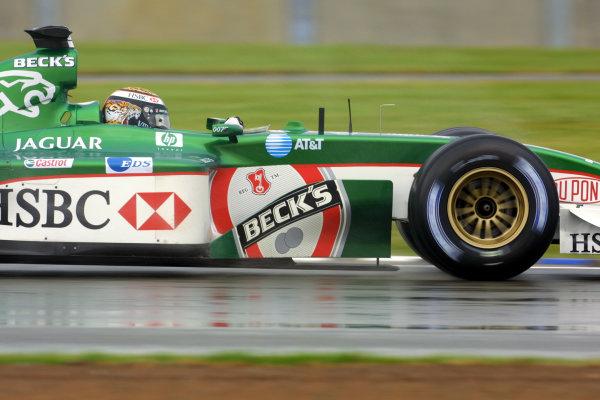 2002 British Grand Prix - Friday PracticeSilverstone, England. 5th July 2002.Eddie Irvine (Jaguar R3).World Copyright - LAT Photographicref: digital file