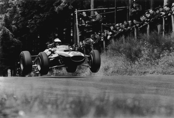 Nurburgring, Germany.30/7-1/8 1965.Jochen Rindt (Cooper T77-Climax) 4th position, jumping action. World Copyright: LAT Photographic.Ref: L65 - 395 - 11.