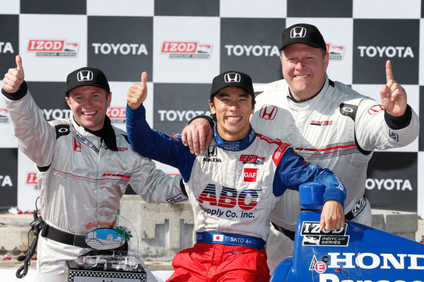 19-21 April, 2013, Long Beach, California, USA Winner Takuma Sato with Roger Griffiths and Paul Metzger of HPD © 2013, Michael L. Levitt LAT Photo USA.