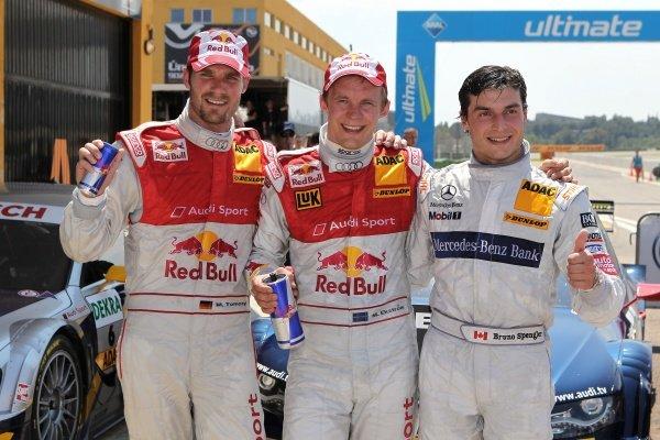Top three finishers: 1st Mattias Ekstrom (SWE), Audi Sport Team Abt Sportsline, centre.2nd Martin Tomczyk (GER), Audi Sport Team Abt Sportsline,  left.3rd Bruno Spengler (CDN), Mercedes-Benz Bank AMG, right.DTM, Rd2, Valencia, Spain. 21-23 May 2010.