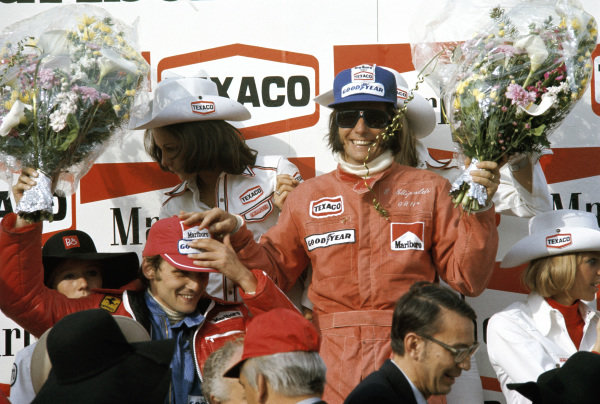 Emerson Fittipaldi celebrates victory with second place Niki Lauda.