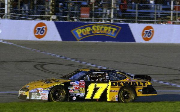 Matt Kenseth (USA), Smirnoff Ice/DeWalt Ford Taurus, celebrates winning his Winston Cup title. NASCAR Winston Cup Series, Rd35, Pop-Secret Microwave Popcorn 400, Rockingham, North Carolina, USA. 9 November 2003.DIGITAL IMAGE