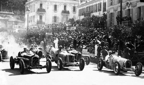 Monte Carlo, Monaco. 2 April 1934.L to R: Carlo Felice Trossi (Alfa Romeo Tipo-B P3), retired, Philippe Etancelin (Maserati 8CM), retired, and Rene Dreyfus (Bugatti T59), 3rd position, at the start of the race, action.World Copyright: Robert Fellowes/LAT PhotographicRef: 34MON01
