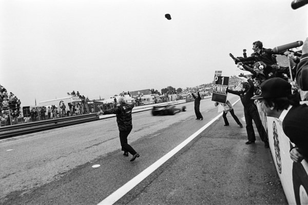 1978 Austrian Grand Prix. Osterreichring, Zeltweg, Austria. 11th - 13th August 1978. Ronnie Peterson (Lotus 79-Ford), 1st position, as Colin Chapman throws his famous cap into the air, action.  World Copyright: LAT Photographic.  Ref:  11676 - 17.