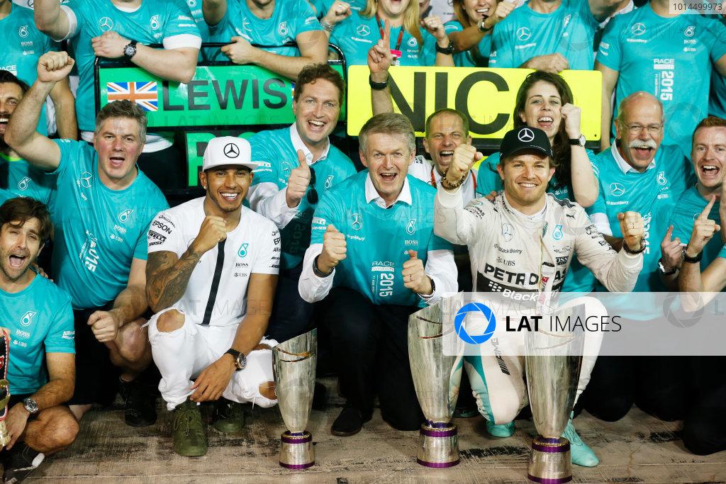 Yas Marina Circuit, Abu Dhabi, United Arab Emirates. Sunday 29 November 2015. Nico Rosberg, Mercedes AMG, 1st Position, Lewis Hamilton, Mercedes AMG, 2nd Position, and the Mercedes team celebrate victory. World Copyright: Alastair Staley/LAT Photographic. ref: Digital Image _R6T4401