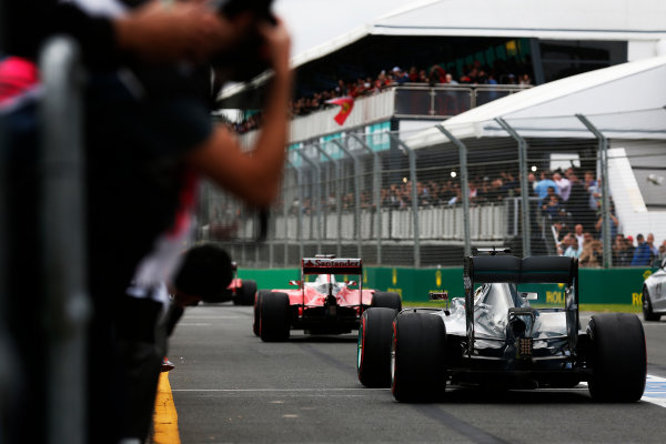 Albert Park, Melbourne, Australia. Saturday 19 March 2016. Kimi Raikkonen, Ferrari SF16-H, leads Lewis Hamilton, Mercedes F1 W07 Hybrid, out of the pit lane. World Copyright: Sam Bloxham/LAT Photographic ref: Digital Image _R6T2590