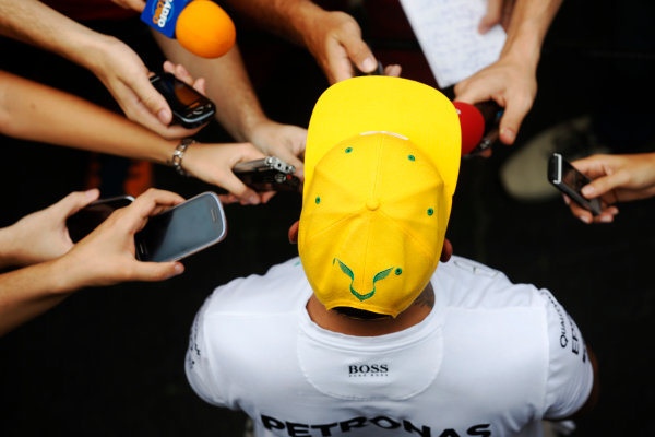 Interlagos, Sao Paulo, Brazil. Friday 13 November 2015. Lewis Hamilton, Mercedes AMG, is interviewed. World Copyright: Alastair Staley/LAT Photographic ref: Digital Image _R6T3766