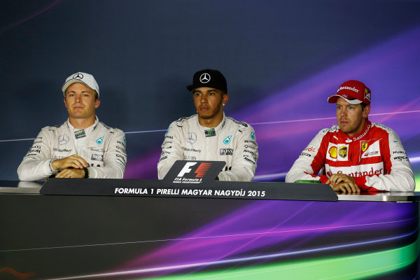 Hungaroring, Budapest, Hungary. Saturday 25 July 2015. Top three qualifiers, Lewis Hamilton, Mercedes AMG, Nico Rosberg, Mercedes AMG, and Sebastian Vettel, Ferrari, in the post-qualifying Press Conference. World Copyright: Alastair Staley/LAT Photographic ref: Digital Image _R6T9764