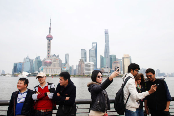 Shanghai International Circuit, Shanghai, China. Wednesday 8 April 2015. People take photos at the Bund in Shanghai. World Copyright: Steven Tee/LAT Photographic. ref: Digital Image _X0W4380