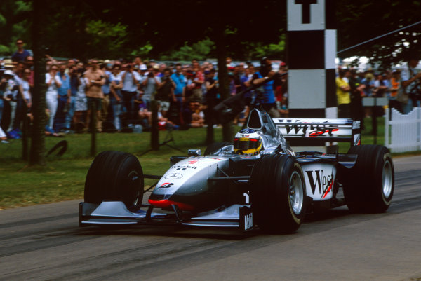 Goodwood House, East Sussex, England. 18th - 20th June 1999.Nick Heidfeld (McLaren MP4/13), sets the record for the hill climb, action.World Copyright: Jeff Bloxham/LAT Photographic.