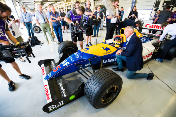 Williams 40 Event Silverstone, Northants, UK Friday 2 June 2017. Photographers and camermen takes pictures of Karun Chandhok aboard a Williams FW14 Renault. Its former driver Riccardo Patrese kneels next to the cockpit. World Copyright: Sam Bloxham/LAT Images ref: Digital Image _W6I6621