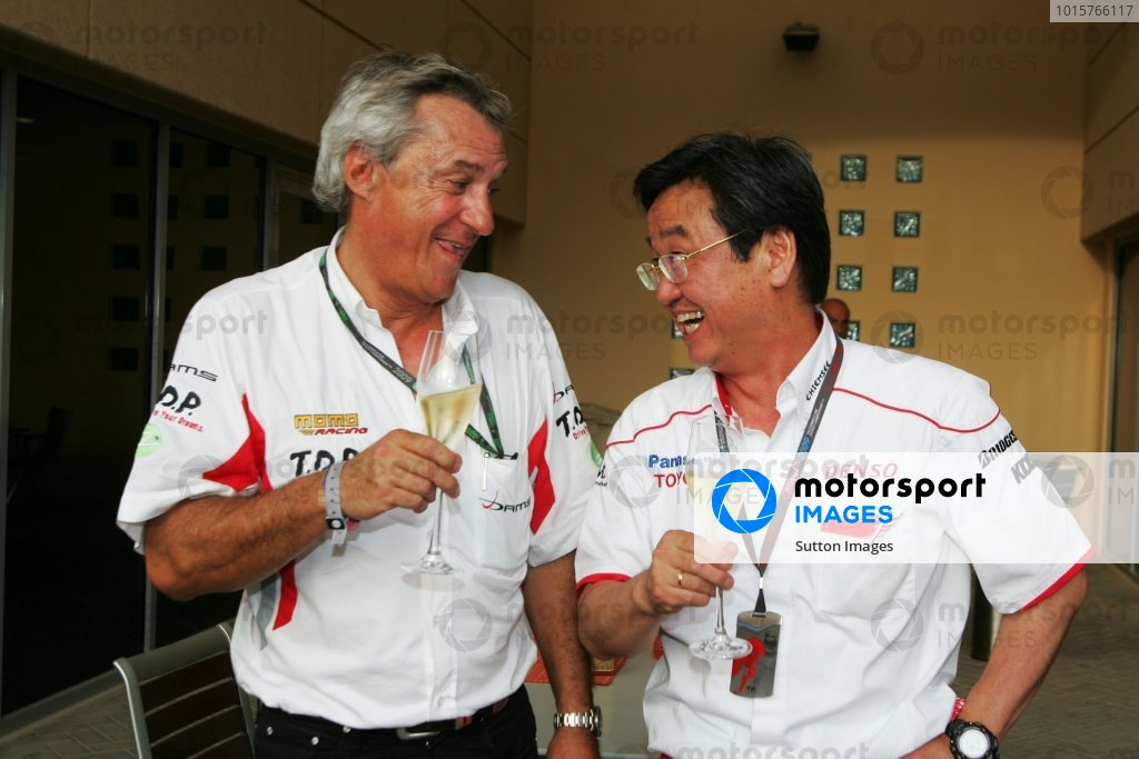 Jean-Paul Driot (FRA) DAMS Team Boss celebrates with Tadashi Yamashina (JPN) Toyota F1 Chairman after Kamui Kobayashi (JPN) DAMS won the GP2 Asia Championship. Formula One World Championship, Rd 4, Bahrain Grand Prix, Qualifying Day, Bahrain International Circuit, Sakhir, Bahrain, Saturday 25 April 2009.