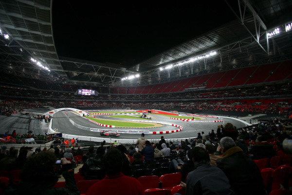 Crowds watch the ROC action at Wembley Stadium as Lewis Hamilton (GBR) demonstrates his McLaren.