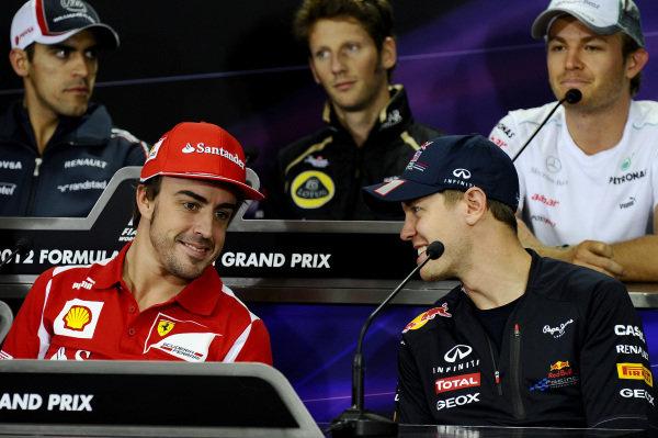 (L to R): Fernando Alonso (ESP) Ferrari and Sebastian Vettel (GER) Red Bull Racing in the Press Conference.Formula One World Championship, Rd16, Korean Grand Prix, Preparations, Korea International Circuit, Yeongam, South Korea, Thursday 11 October 2012.