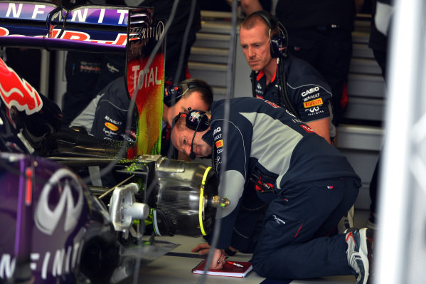 Adrian Newey (GBR) Red Bull Racing Chief Technical Officer looks at the aero paint pattern on the rear of the Red Bull Racing RB9. Formula One World Championship, Rd9, German Grand Prix, Practice, Nurburgring, Germany, Friday 5 July 2013.